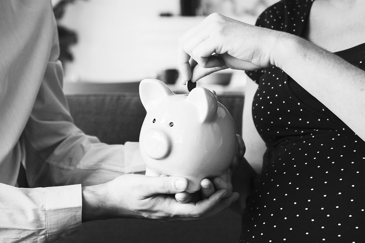 Husband and Wife with Piggy Bank